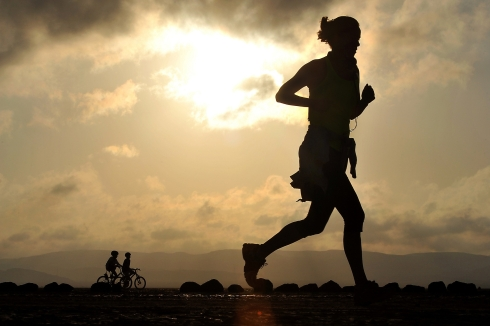 Canva - Silhouette of a Woman Running